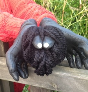 Let's Play Music - Incy Wincy Spider Puppet made out of a ball of wool, two buttons and a pair of old gloves!